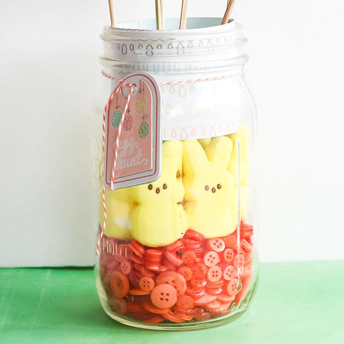 peeps and buttons in a glass jar