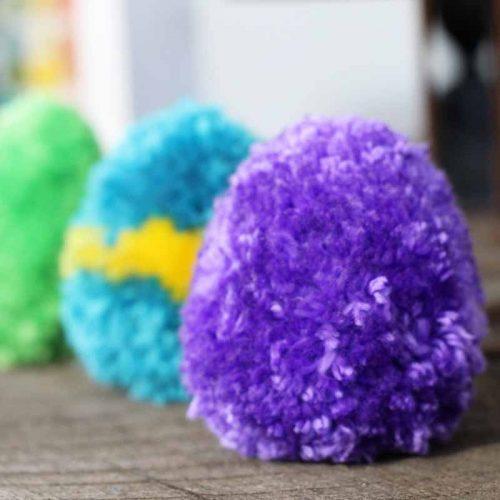 Purple, blue, and green pom pom eggs.