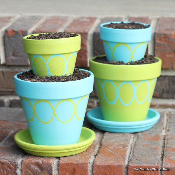Tiered and painted terra cotta pots