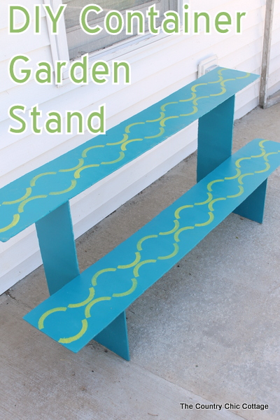 DIY Container Garden Stand that is perfect for a deck or porch. Gorgeous stenciled details! Click for the plans for build.
