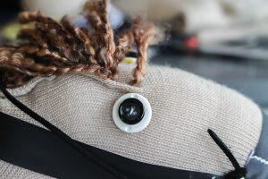 button eyes on a sock horse head