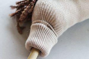 folding sock to add to a dowel rod