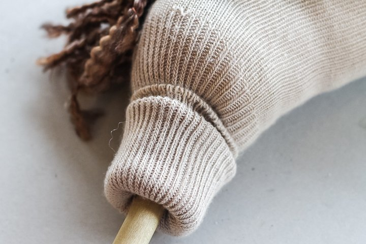 folding sock to add to a dowel rod
