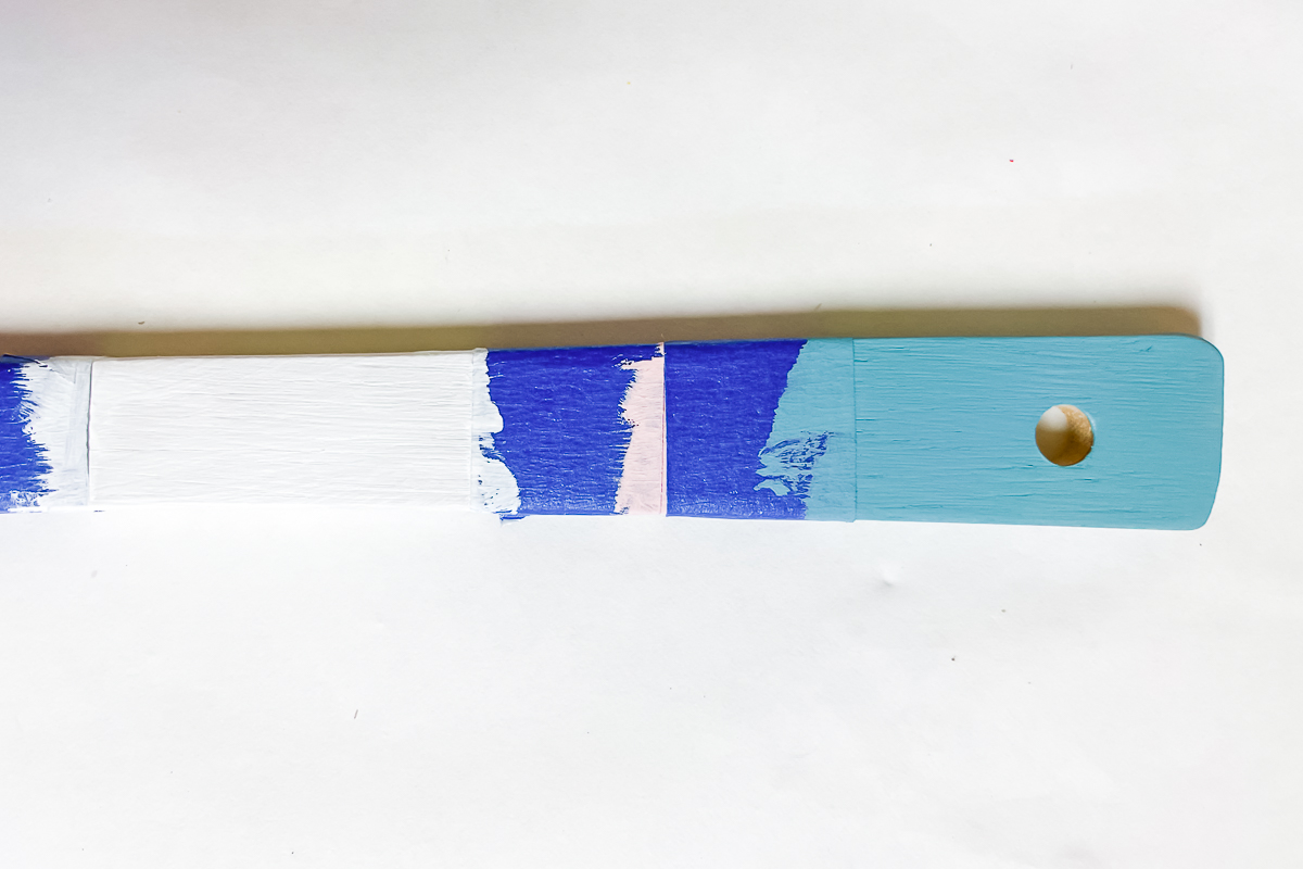 paint on wood spoon handle with masking tape
