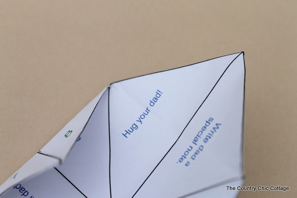 """A free printable Father's Day cootie catcher for your kids. A great way to show dad how much you love him with fortunes like """"hug your dad""""!"""