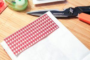 scrap book paper to decorate a gift bag