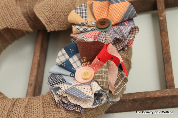 Make a wreath with flowers made from vintage quilt pieces in 10 minutes or less! A quick and easy wreath that anyone can make.