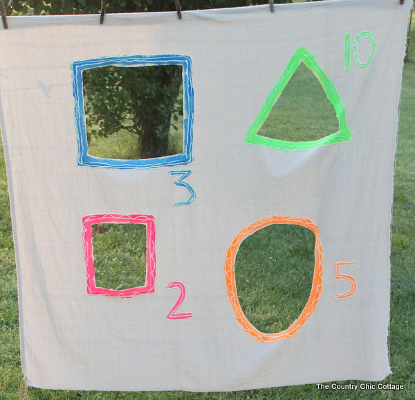 Glow in the Dark Yard Game -- make a summer of fun memories by adding yard games to your backyard or party. This glow in the dark game does not have to stop when the sun goes down!