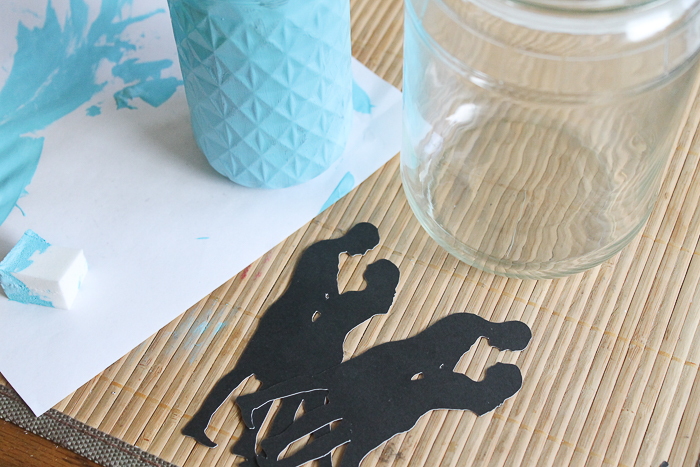 Cutting couple silhouettes with your Cricut machine to make mason jar centerpieces.
