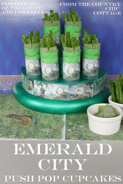 A great display of push pop cupcakes that looks like the Emerald City from Oz the Great and Powerful!