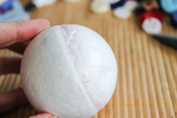 cutting a styrofoam ball