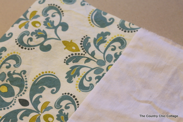 The excess fabric at the end of your curtain is ironed flat and now your sides are ready to be sewn