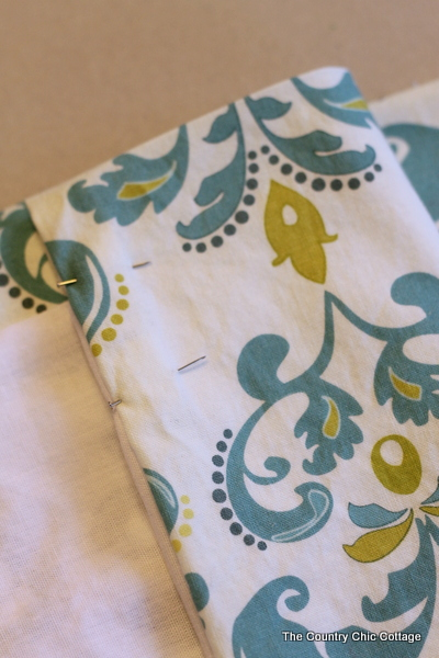 Placing pins in your curtain fabric makes sewing them much easier