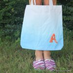 button monogram tote