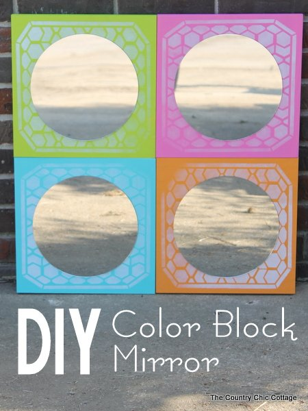 DIY Color Block Mirror -- make this mirrored art for any room in your home easily with a few simple steps. Click to see where to buy the boards, mirrors, paint and stencils to make this great mirror!