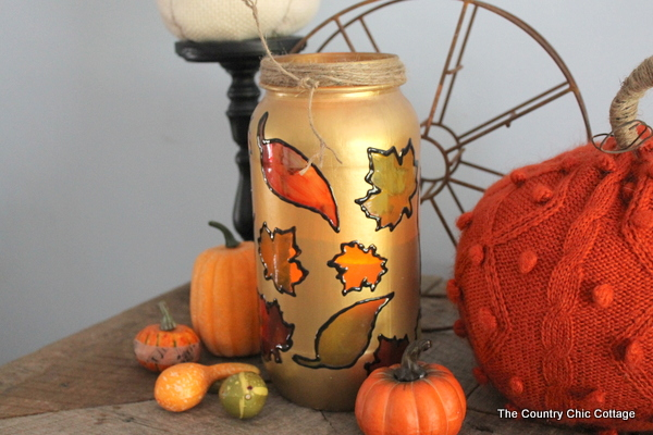 Fall Jar Luminary -- turn a mason jar or old pickle jar into a great fall jar luminary for your home decor. Some glass paints and masking is all it takes!