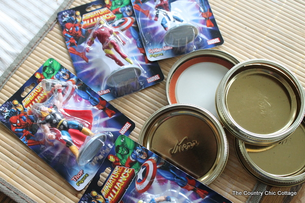 superhero figures and lids