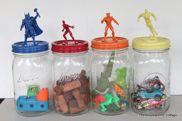 four jars with superheros