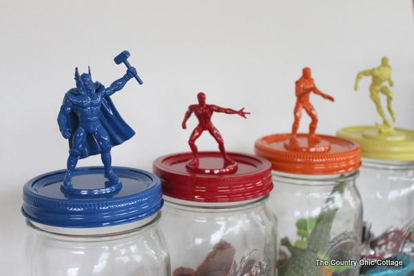 superhero figures on top of jars