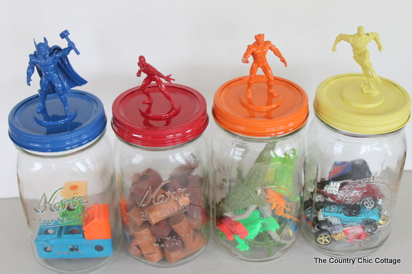 four different colored jars with different objects