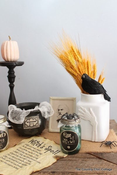 Bone Hand Halloween Vase Pottery Barn Knock Off -- come see how to make your own bone hand vase quickly and easily with this Halloween craft tutorial.