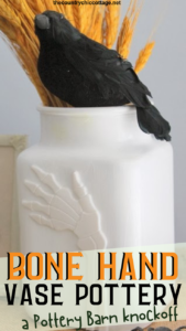 Make this DIY Halloween vase for less than $5 with a few simple supplies! This quick and easy bone hand vase is the perfect addition to your Halloween decor! #halloween #vase #homedecor #scary