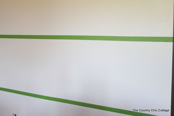Apply the painters tape to your wall, using the markings you measured out.