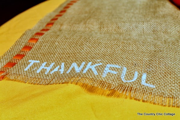 thankful written in paint on burlap placemat