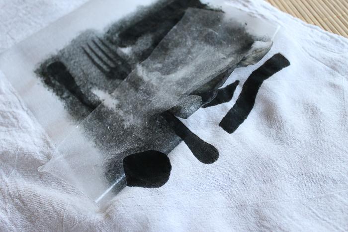 stenciling a dish towel