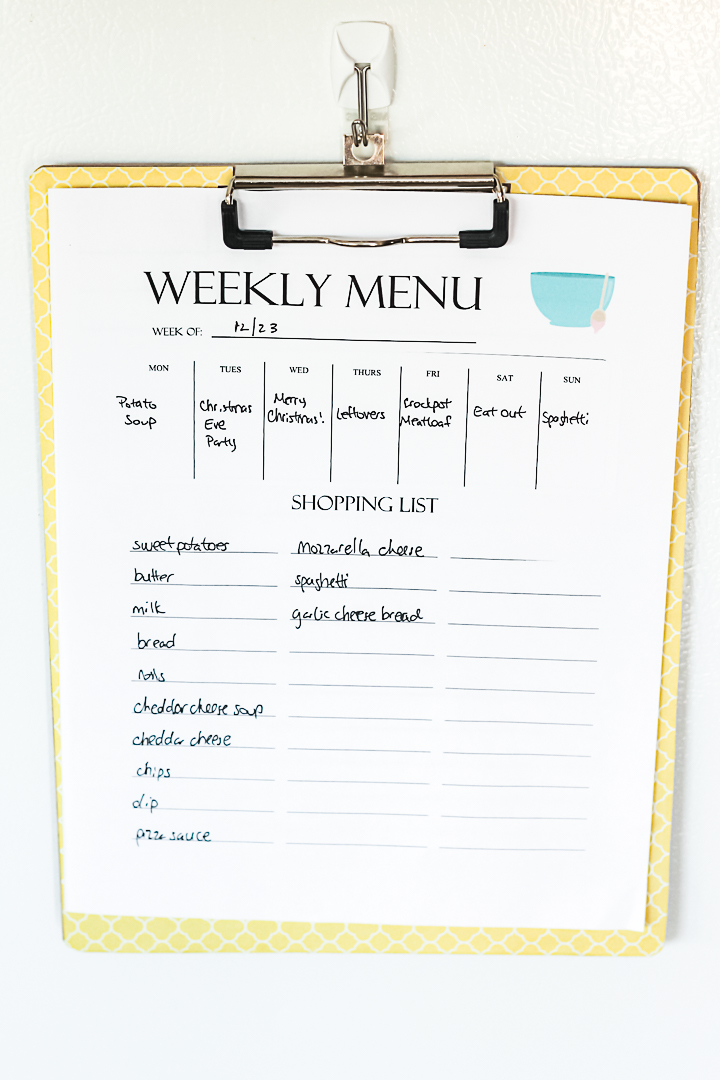 menu planner on side of refridgerator