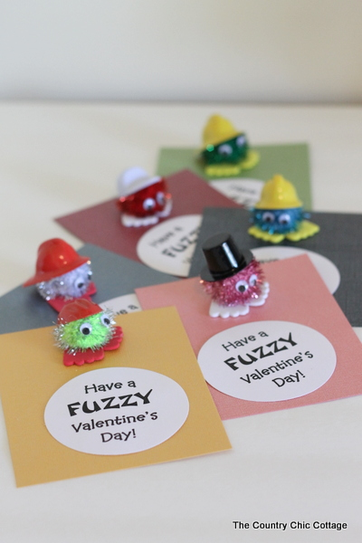 Homemade valentine card with pom-pom character