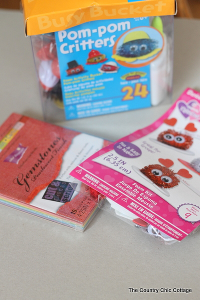 Supplies to make pom-pom critter valentine cards