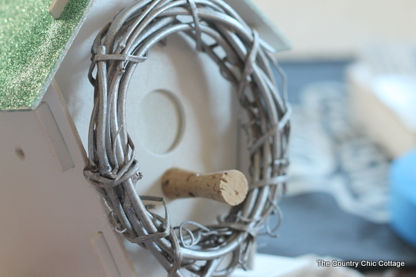 Birdhouse Twine Organizer -- take a messy bunch of twine or string and get it organized in a fun birdhouse. #krylonCHA  Click to get the full instructions on how to make your own.