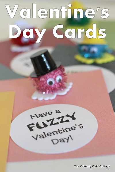 Homemade valentine card with pom-pom character and text overlay
