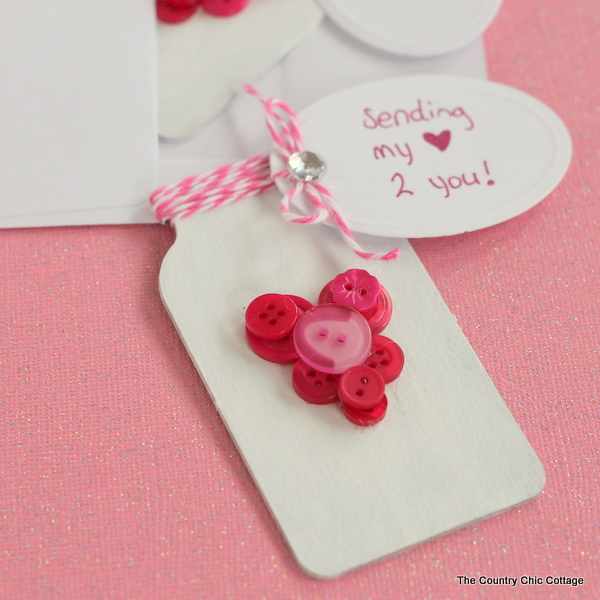 Mason Jar Valentines -- give a mason jar this Valentine's Day with this super simple button heart jar.  Click to get the instructions on making your own.