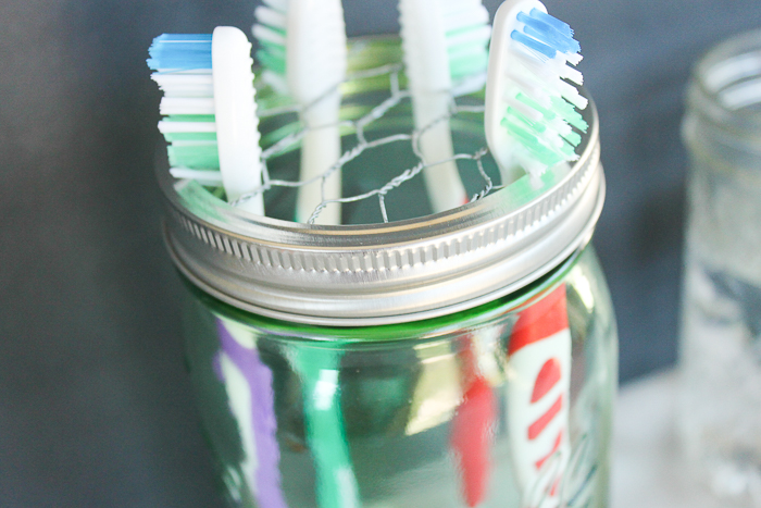 Mason jar toothbrush holder made with chicken wire