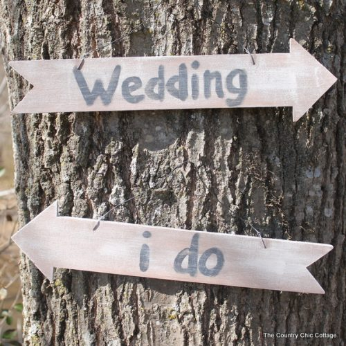Two wedding signs on tree