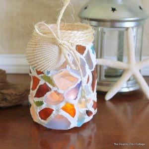 Sea Glass Mason Jar -- a fun way to use your sea glass collection. Make this mason jar candle holder easily!