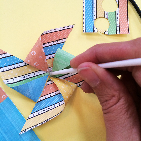 Fold corners to center and glue in place