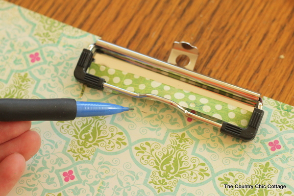 tracing pattern paper around a clipboard clip