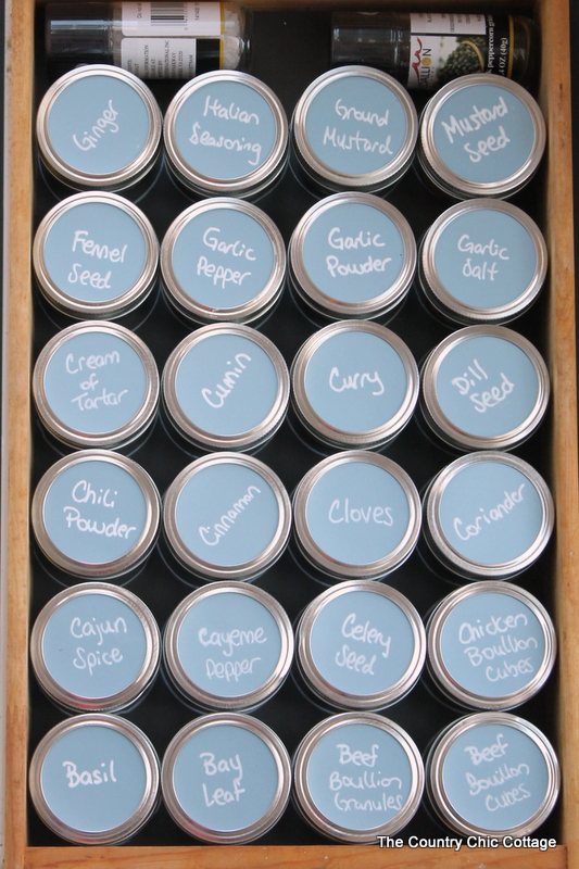 Organizing spices with mason jars -- learn how to use mason jars and chalkboard paper to organize your spice drawers.  A great kitchen organization idea!