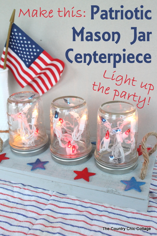 Patriotic Mason Jar Centerpiece for the Fourth of July -- make this centerpiece and light up your party in style! A fun way to add string lights to your table in mason jars! Easy to make by following this craft tutorial.