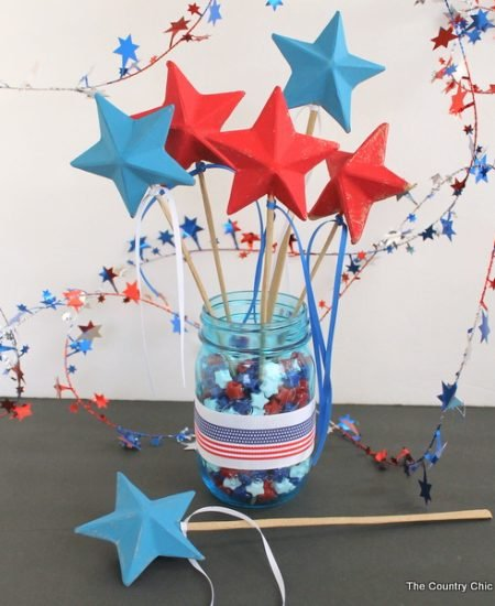 Patriotic Wand Centerpiece -- make a fun centerpiece with patriotic wands for your Fourth of July party. The kids can take home the wands at the end of the night.