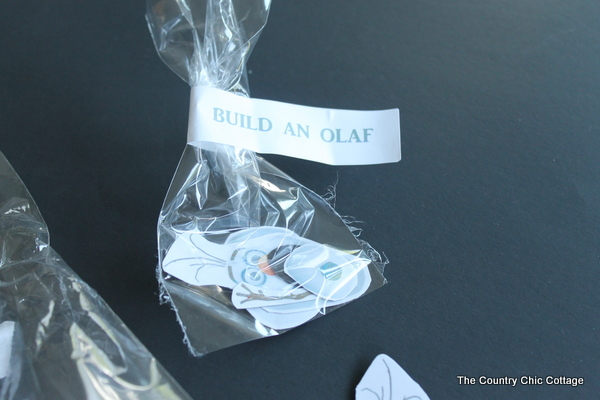 Olaf Frozen Party Favors -- quick and easy way to make magnetic Olaf pieces so the kids can build their own Olaf!