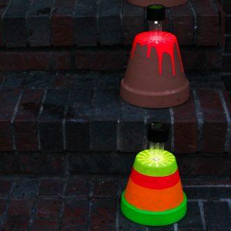 terra cotta pots holding solar lights