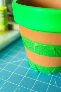 painter's tape on terracotta pot