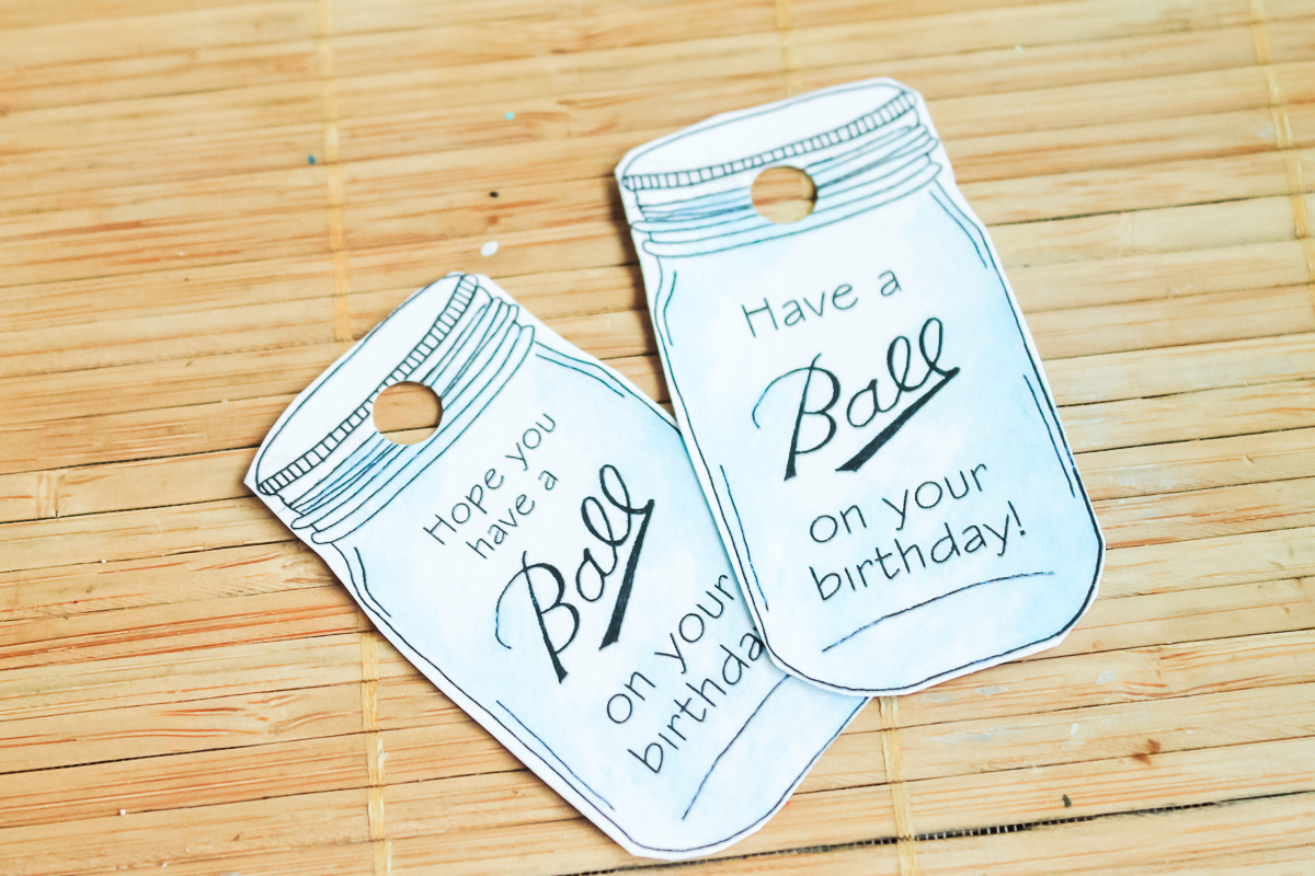 tags for a birthday gift cut out with a hole punched in them