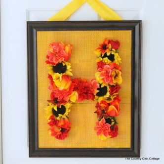 Floral Monogram Wreath -- supplies from Dollar General transform into a gorgeous one of a kind wreath. Get the full instructions for making your own here.