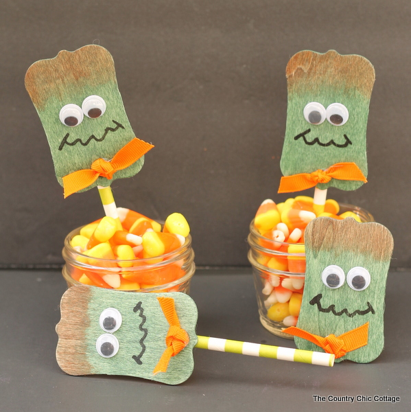 Frankenstein Wood Projects -- Halloween ideas using wood tags to make Frankenstein pins and cupcake toppers!