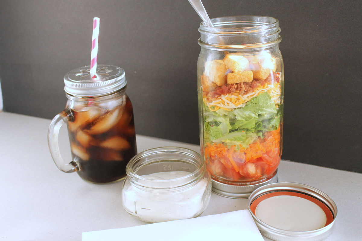 How to Assemble a Mason Jar Salad -- grab your ingredients and throw together an amazing salad in a mason jar. Great instructions on how to keep your salad fresh!